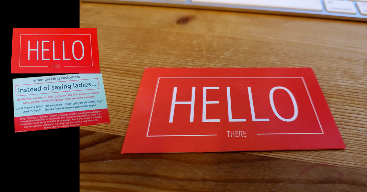 Business card on a desk: Instead of saying ladies... consider using gender inclusive language