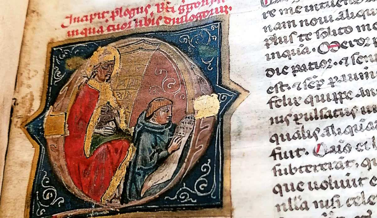 A 14th century letter Q with an image of gregory the great and a scribe working inside it.